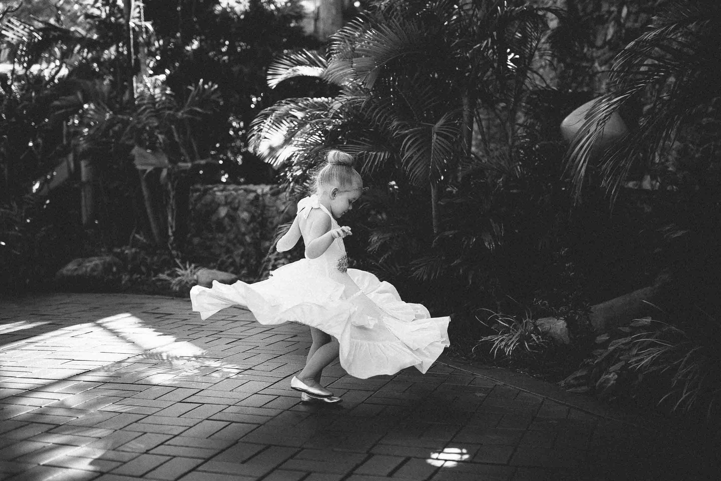 the flower girl spinning around as fast as she can