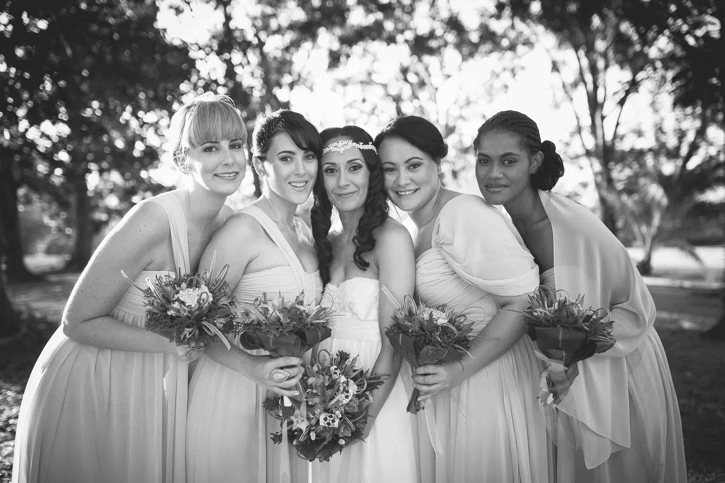 bridesmaids having a photo with the bride