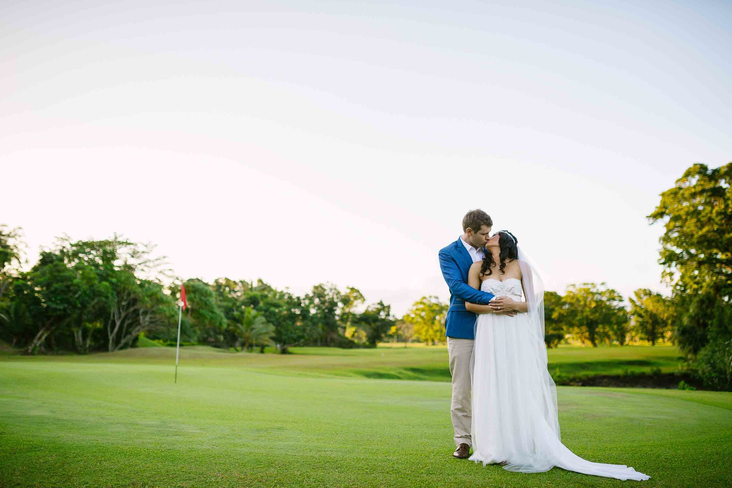 a portrait of the couple on the Pearl Championship Fiji Golf Course