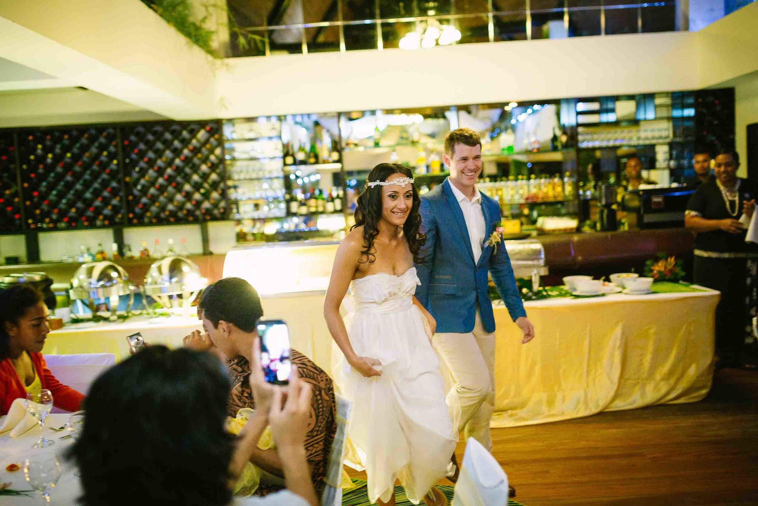 bride and groom entering their reception dinner