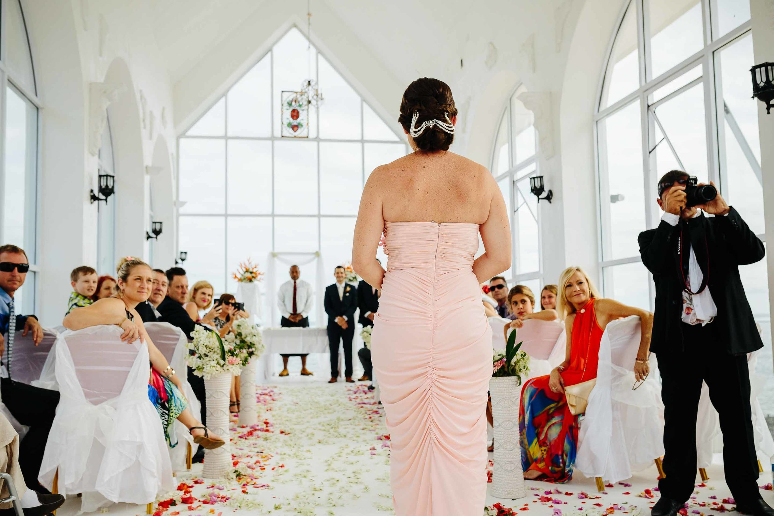 bridesmaid walking down the asile