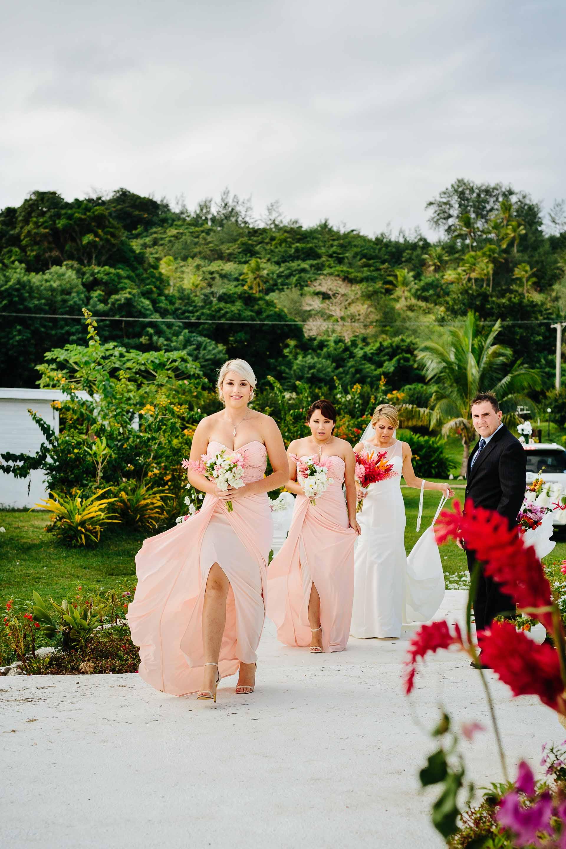 bridesmaids walking down the asile