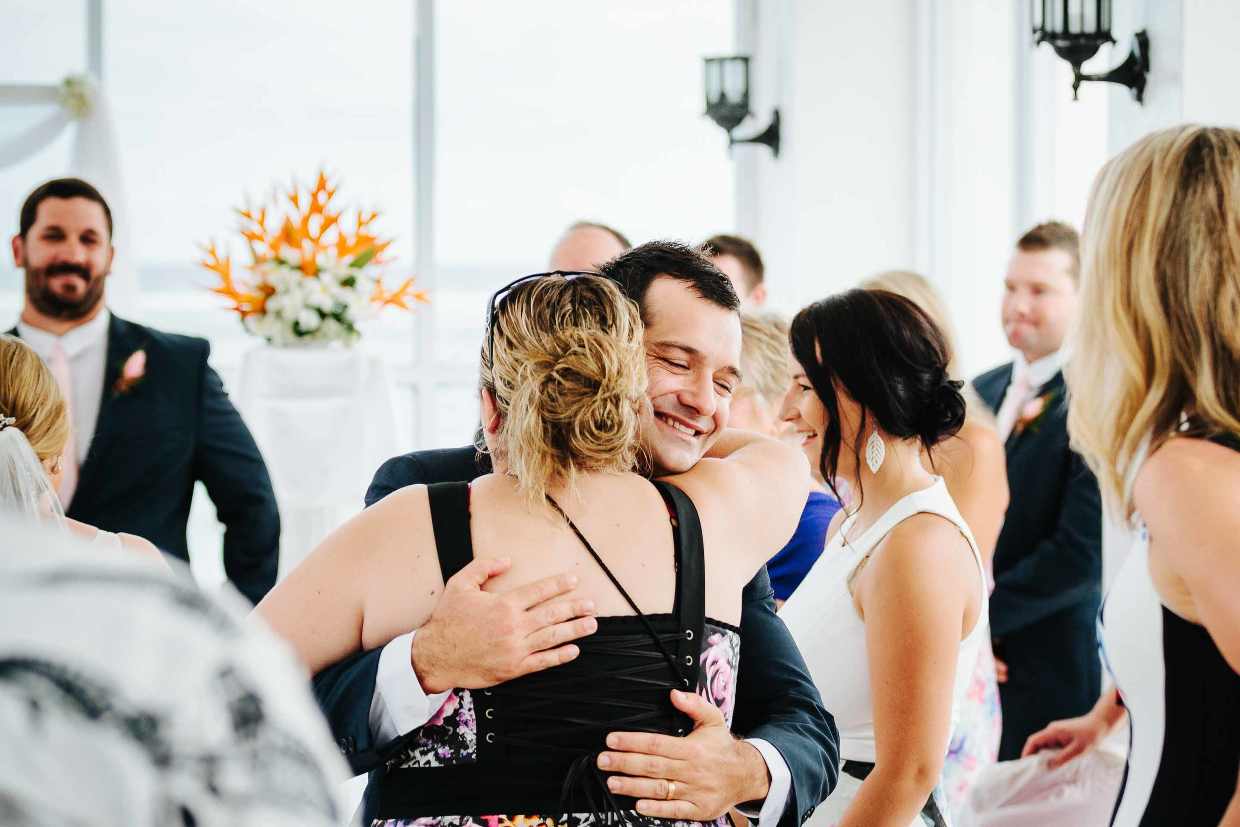 guests congratulating the groom
