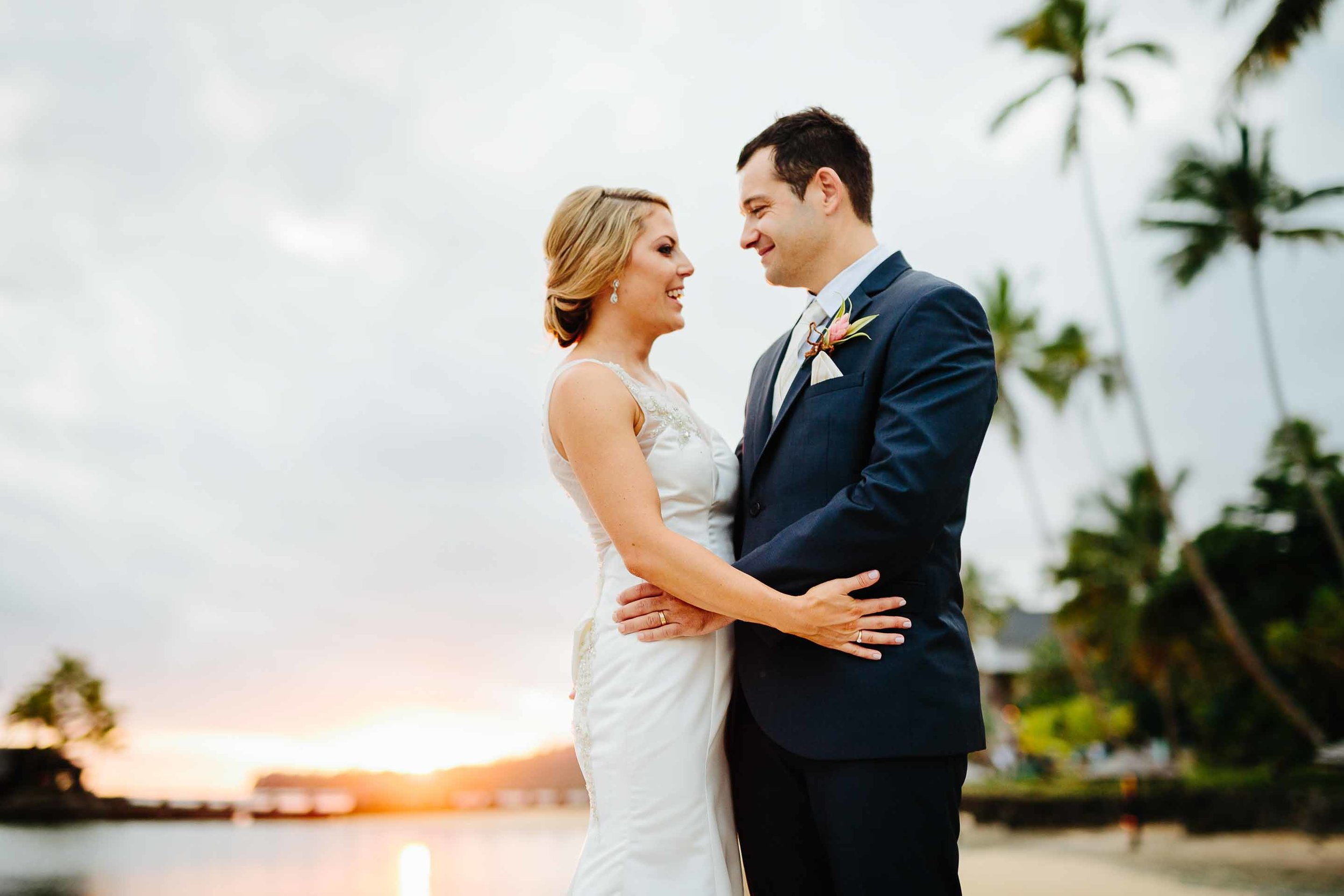 couple with stunning sunset behind them