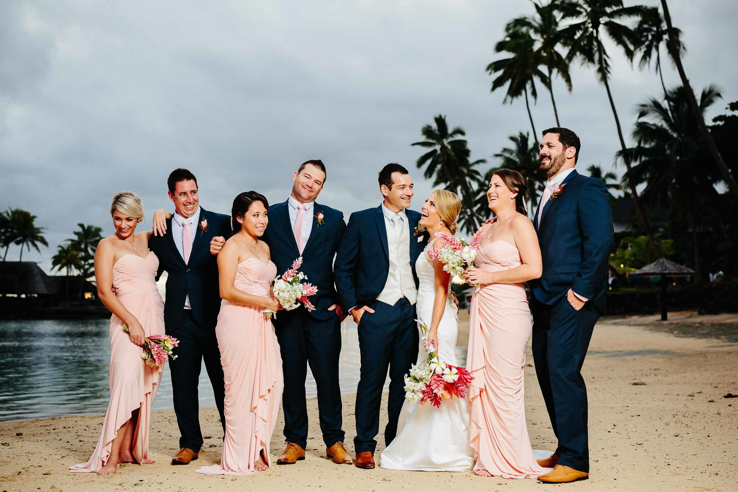 bridal party having fun on the beach