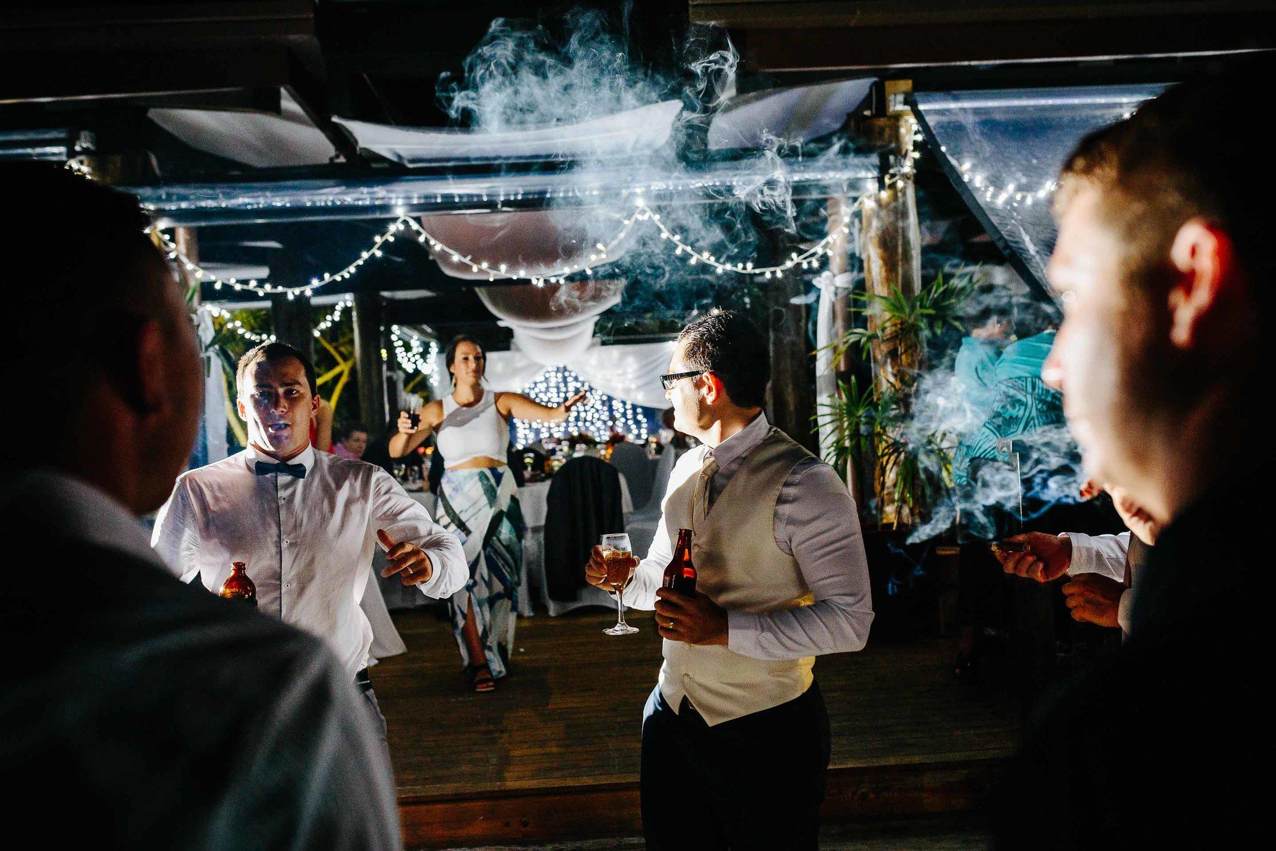 groomsmen smoking cigars