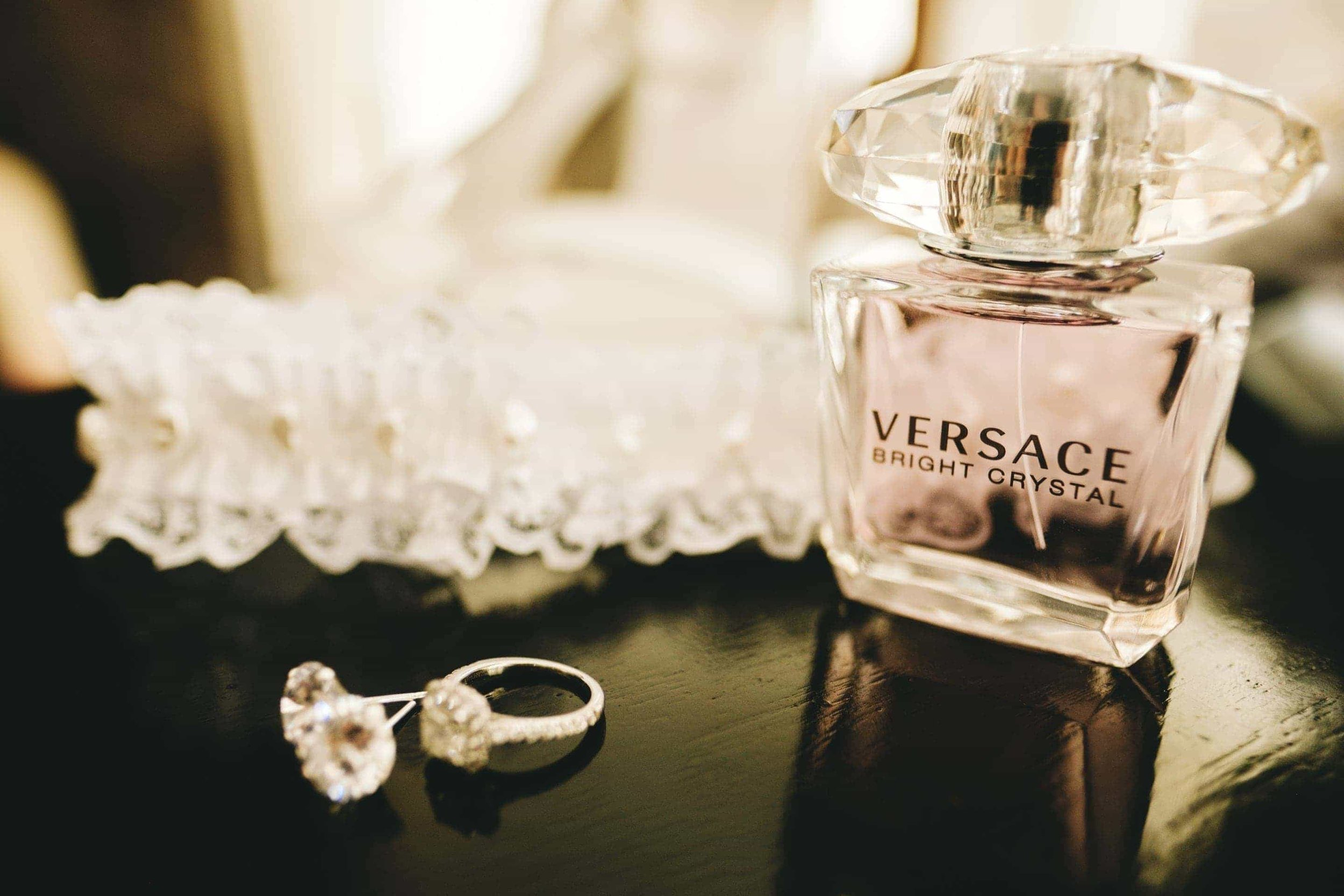 The brides engagement ring, earrings, garter belt and Versace perfume