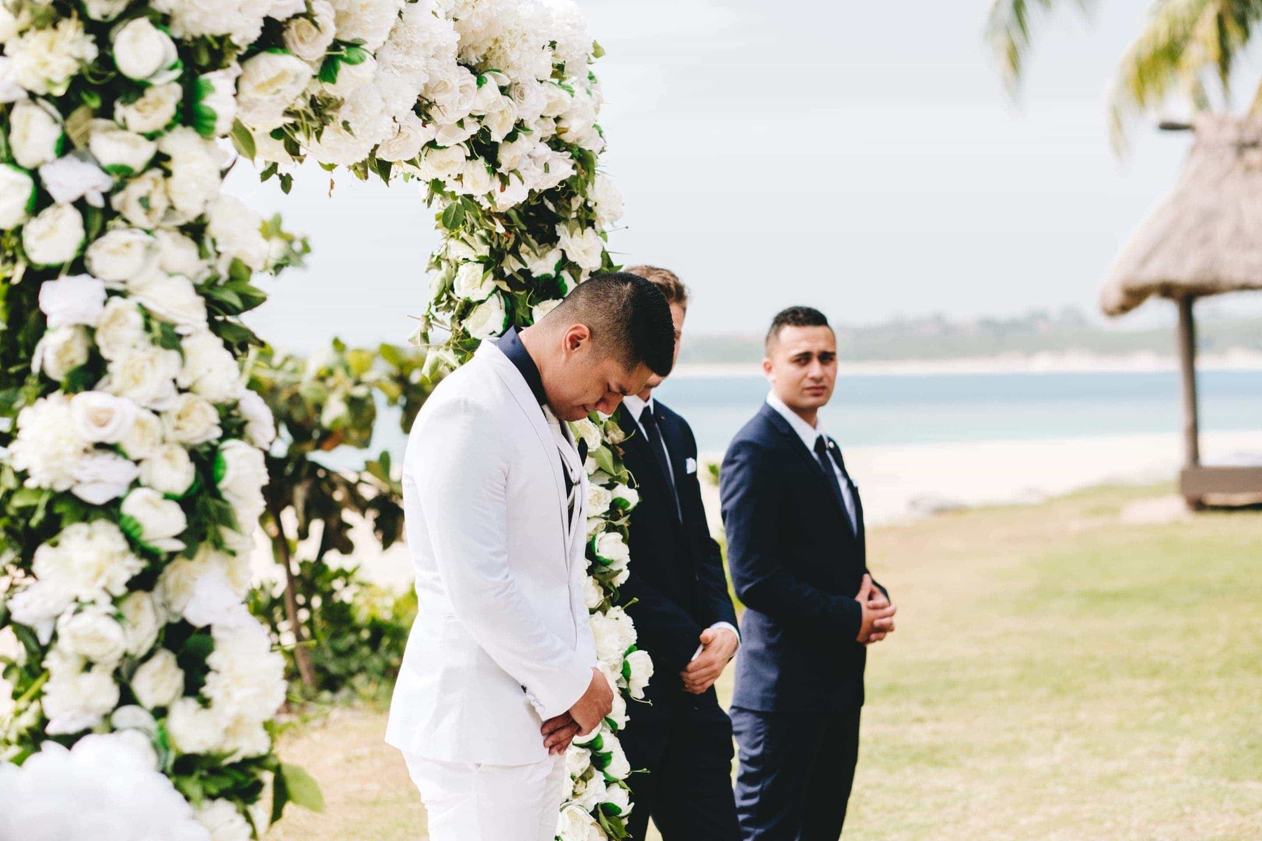 the groom overcome with emotion after seeing his bride fr the first time