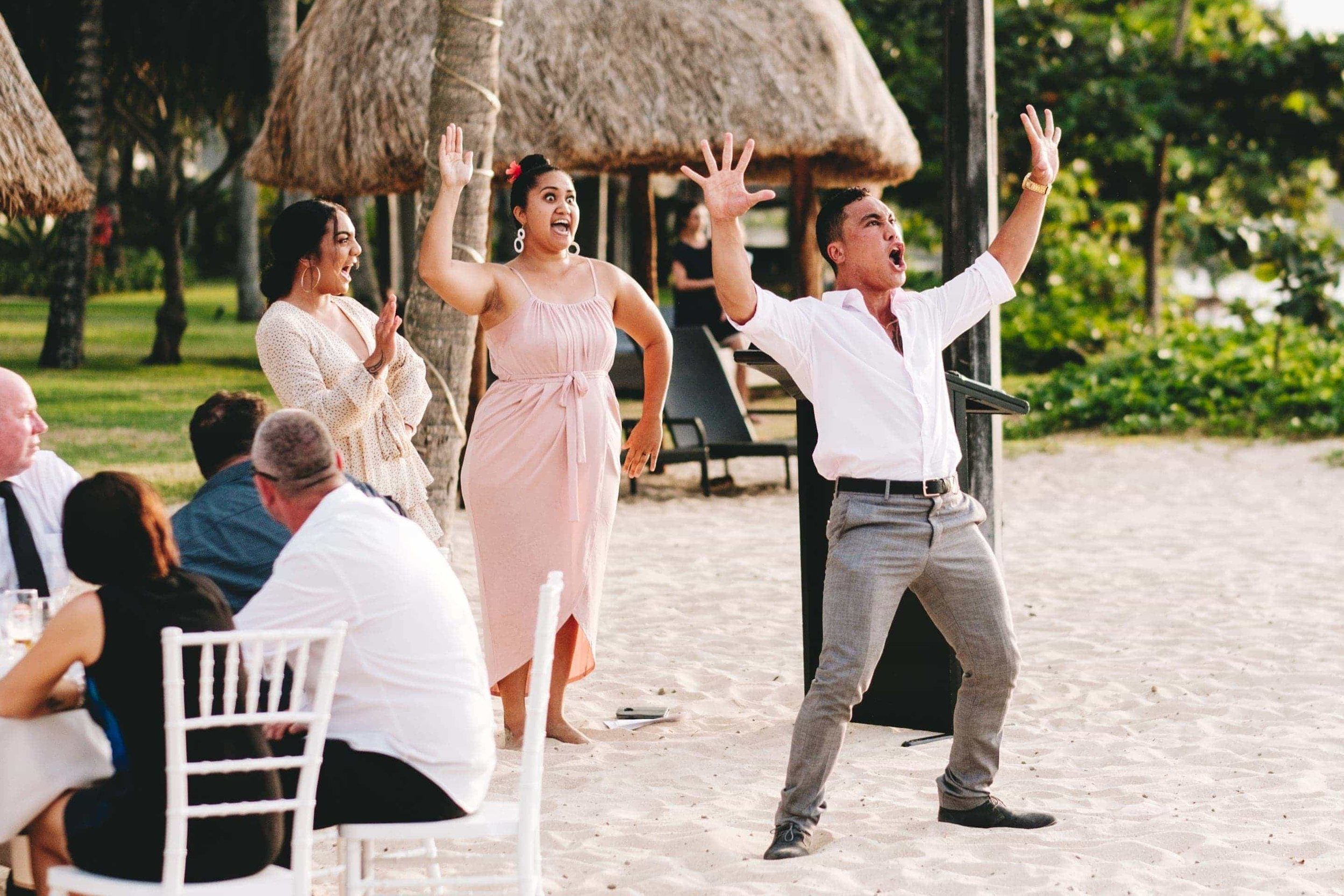 Father of the groom and family preform a haka for the wedding couple