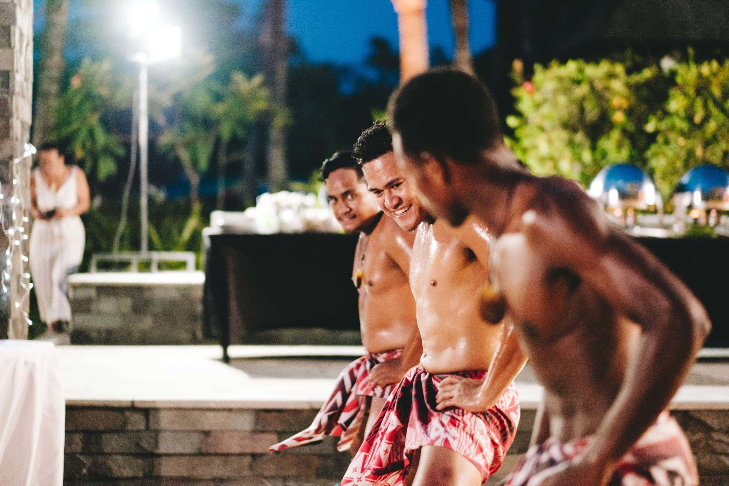Polynesian dancers preform for the wedding guests
