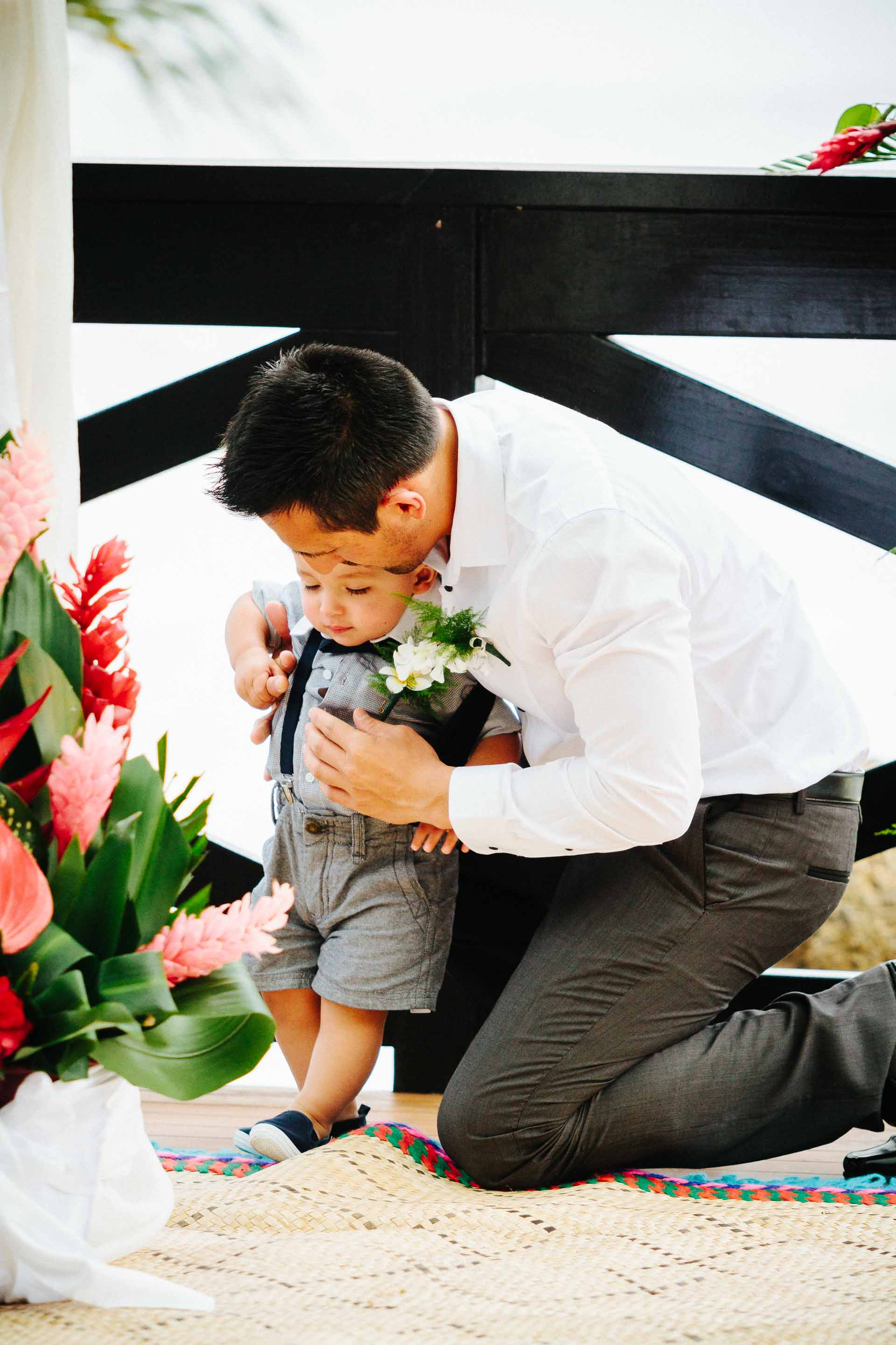 Groom comforting his son