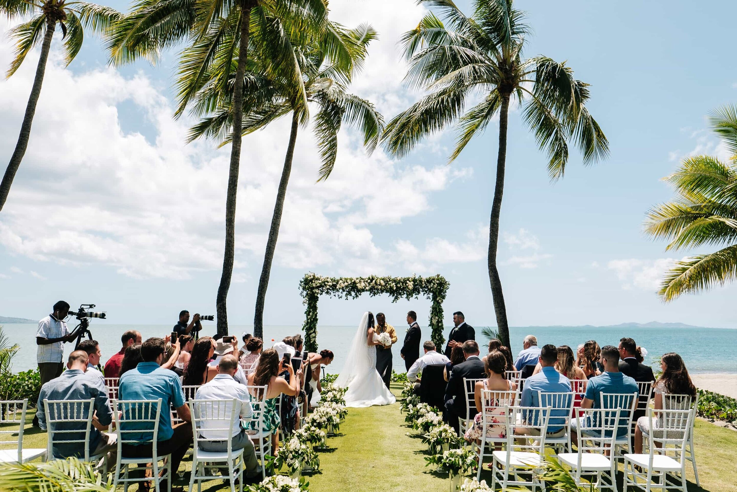 A ceremony at the Wedding Lawn by the beach at the Sheraton Fiji