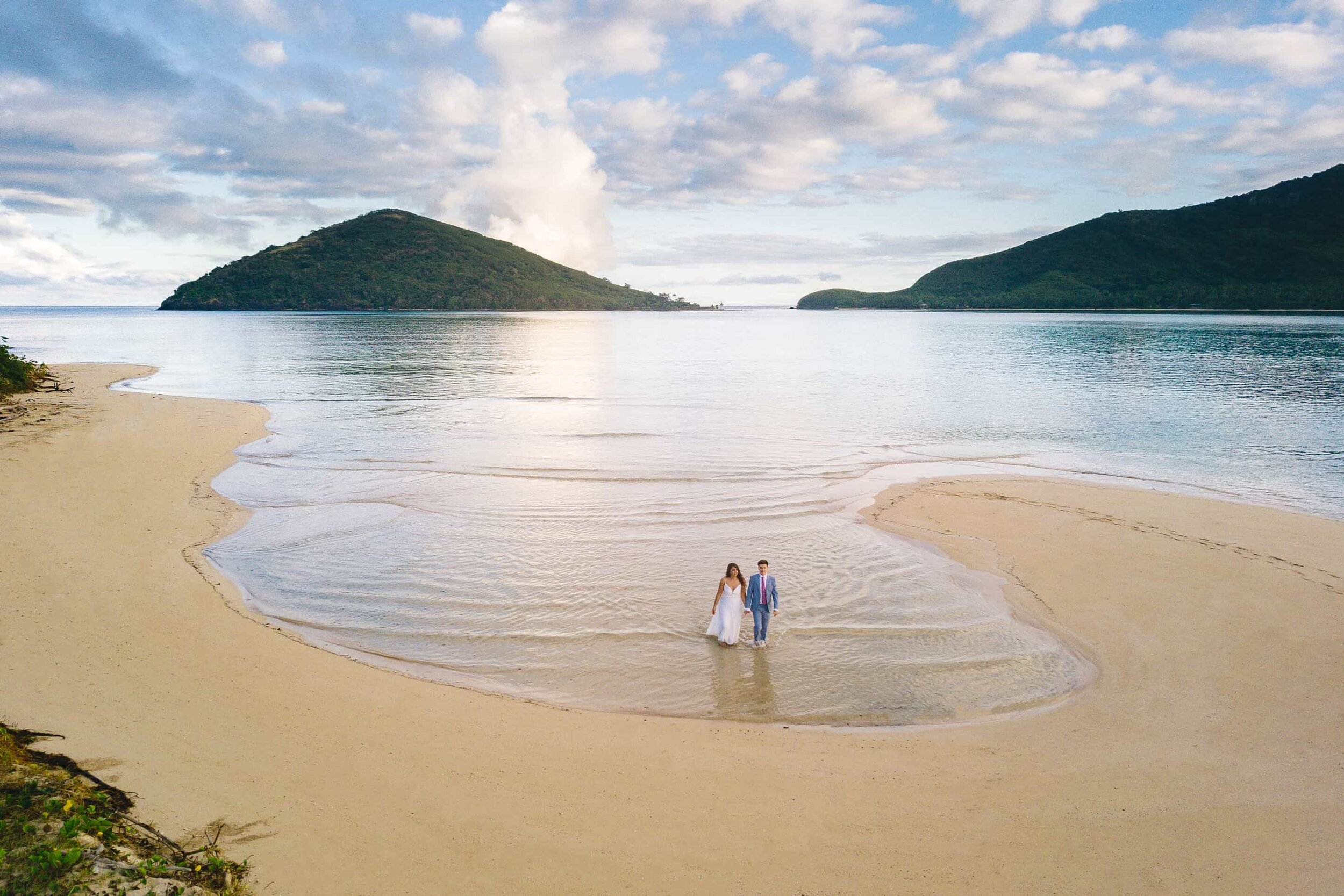 Aerial photo of a newly married elopement couple on a secluded beach in Fiji
