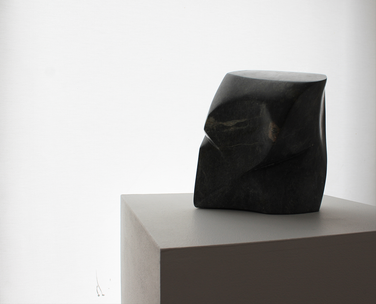 Torso of a young boy and a hole to pick him up by, Soapstone, 23x21x15cm $850