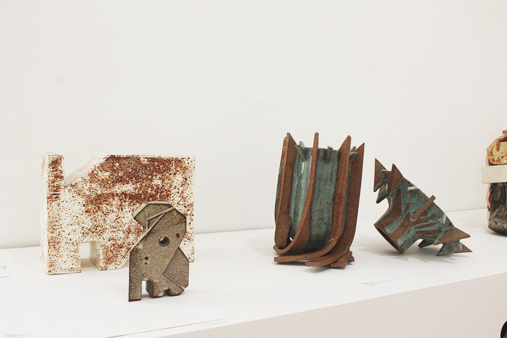 From left to right:  Rodney II,  Ceramic, 22x19x9cm,  Delilah , Ceramic, 8x12x3cm; Theodosius Ng,  Spectra , wheel thrown and hand built recycled clay with reduction glaze, 35x35x22cm.