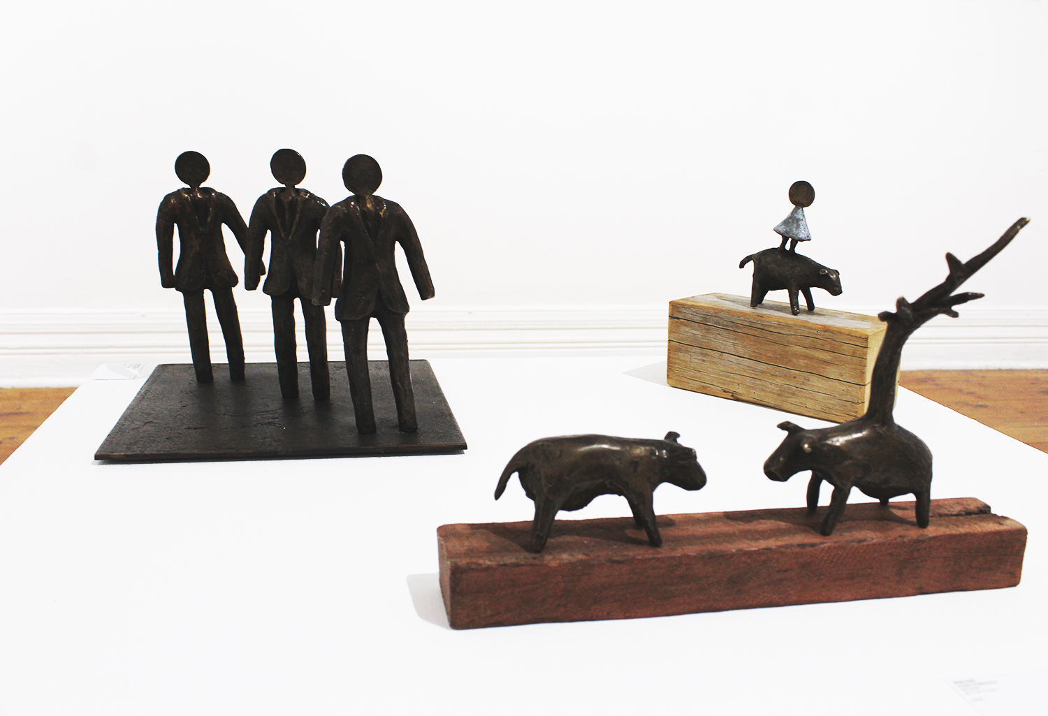 From left to right: Dawn Robinson,  Shelter , bronze, 20x28x25;  The Paddock , Bronze, 30x30x25;  A Penny For Your Thoughts , Bronze, 20x20x25