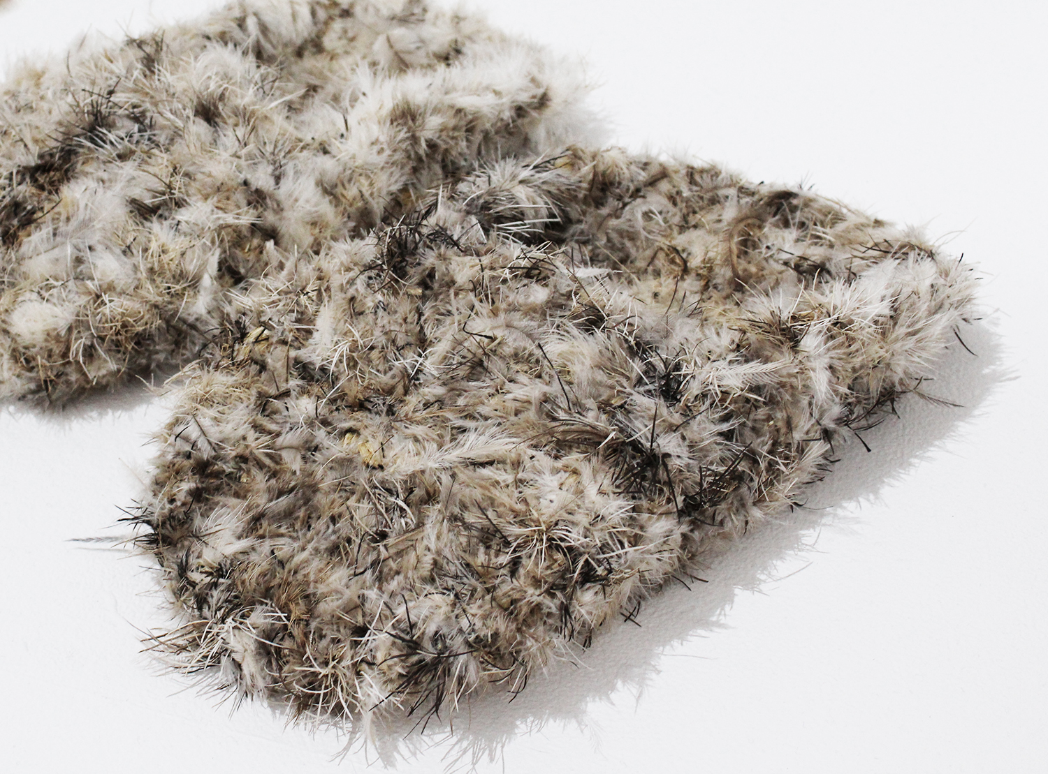 Juanella McKenzie,  Woven Emu Feather Slippers , Emu feathers and natural fibre, 32x16cm