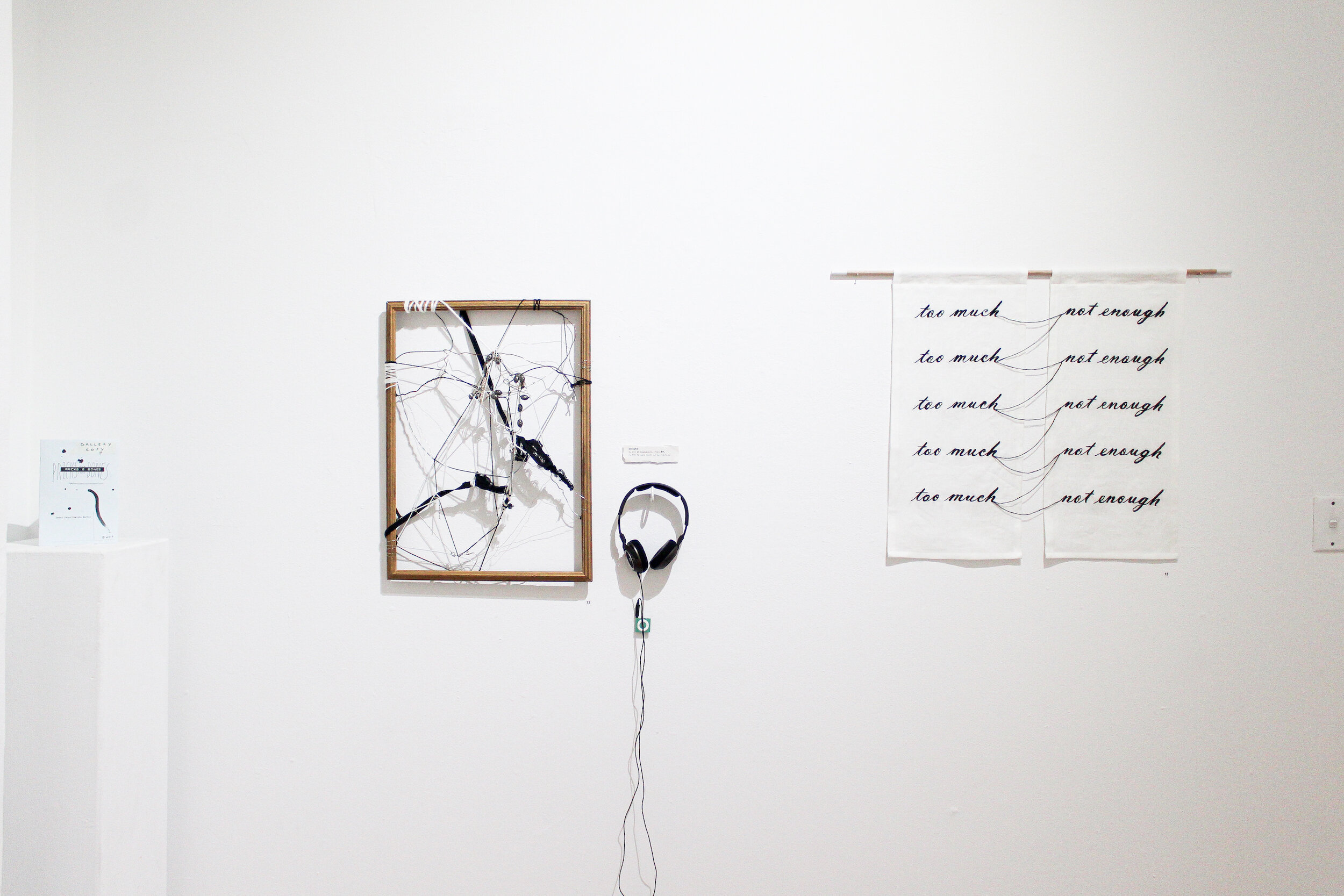Georgia Kartas/Saint Jorge,  Pricks and Bones , audio recording, wooden frame, wire, chain link, string, 21x 30cm.  Amelia Dowling,  All-or-nothing thinking , 2019, hand embroidery, linen, cotton, wood, acrylic paint, 85 x 60cm