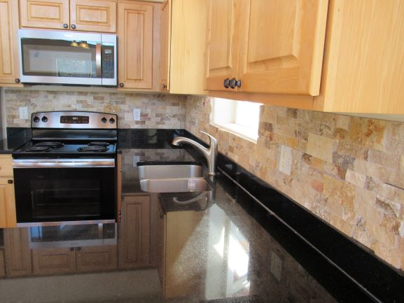Install Stone Tile Backsplash, Hang Over the Stove Microwave, Install Cabinet Knobs in Kitchen