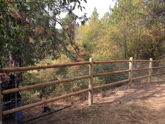 Install Log Fence with 4 Foot Wire Fence