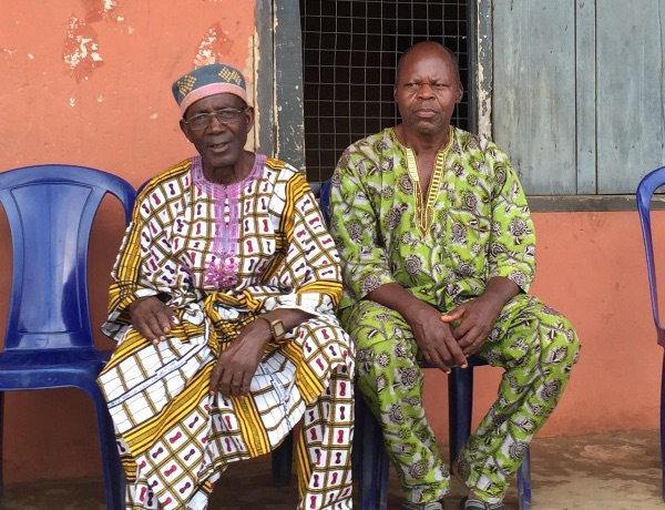 Traditional leaders meet the Rotarians at a school.
