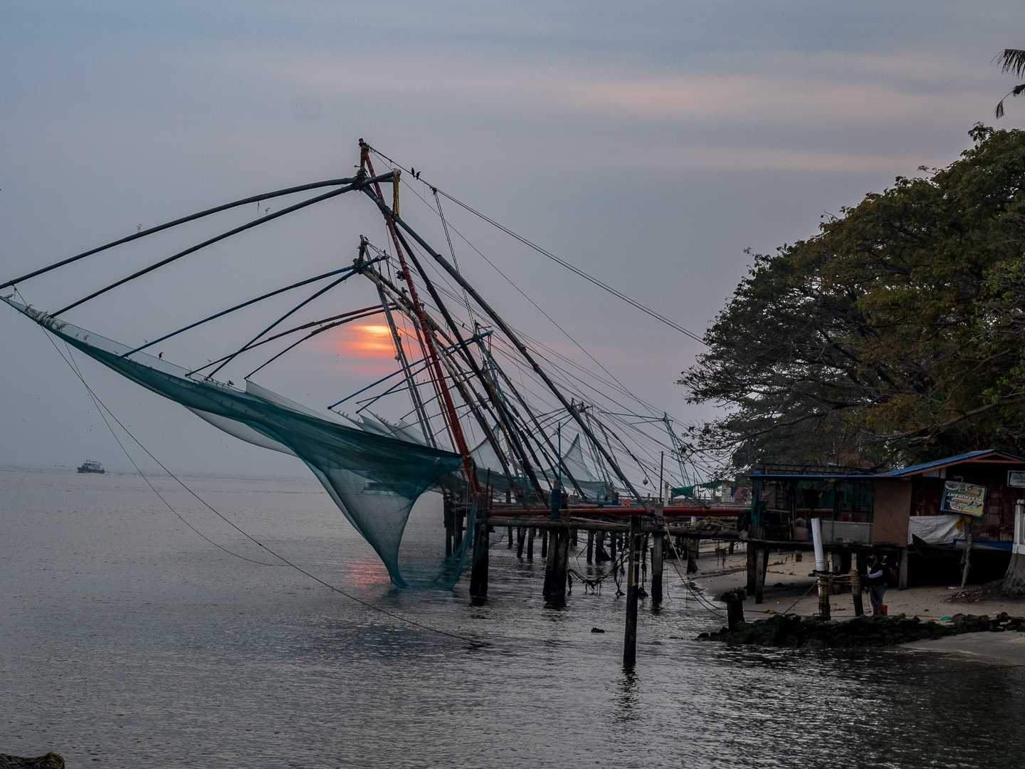Chinese fishing nets at sunset in Cochin harbor