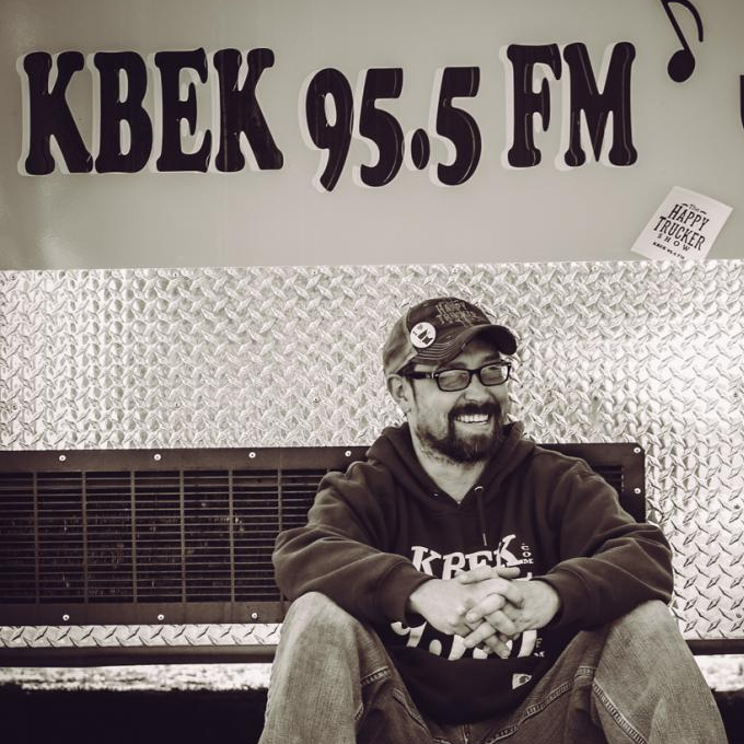 The Happy Trucker has been the voice of many local events, programs, concert series and The Happy Trucker Show on KBEK 95.5 FM, A live radio show that plays 'Songs That Don't Suck'.