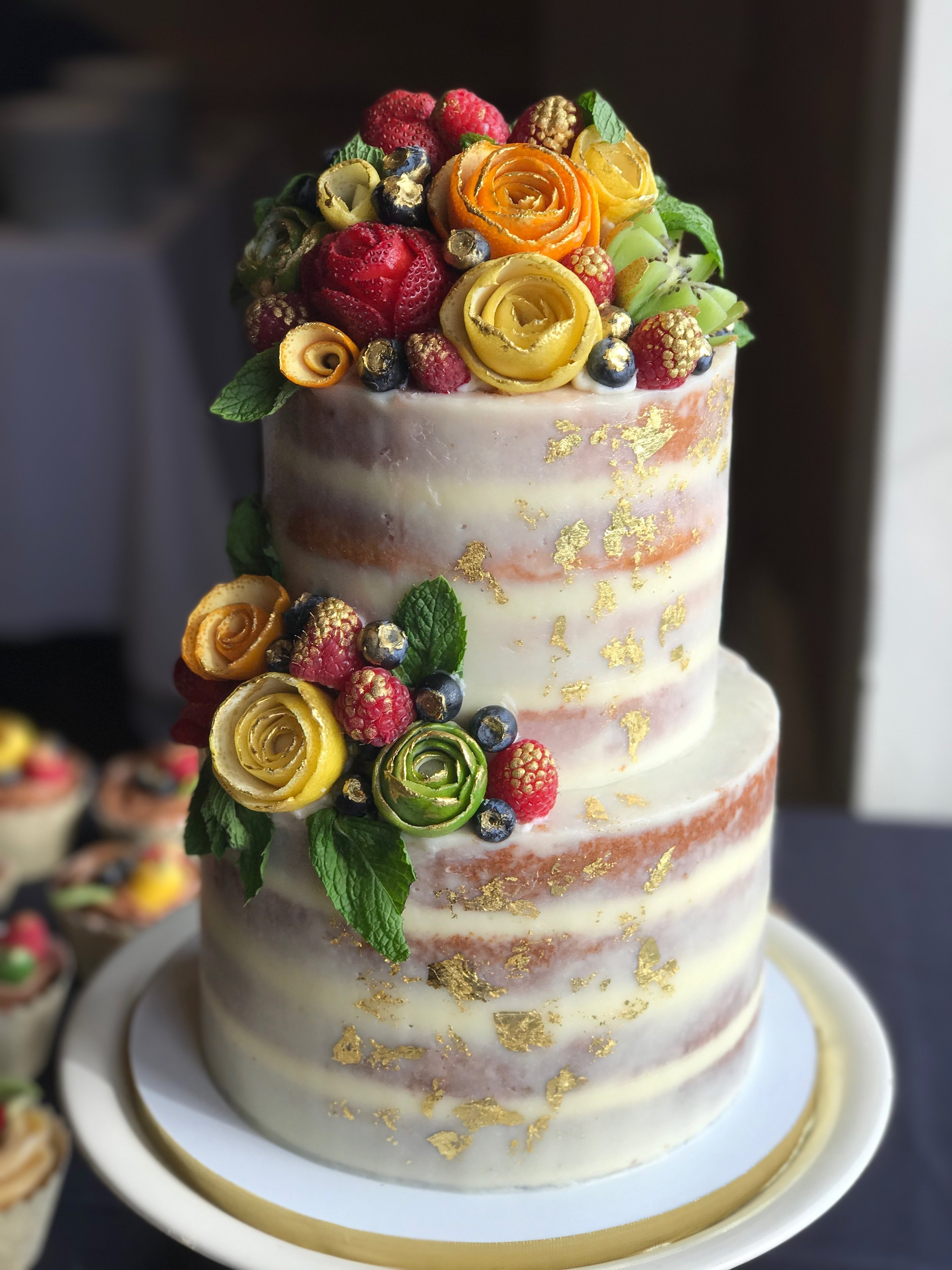 Semi-Naked cake shown with signature fruit flowers. ** Fruit flowers or fresh fresh flowers is an add on**