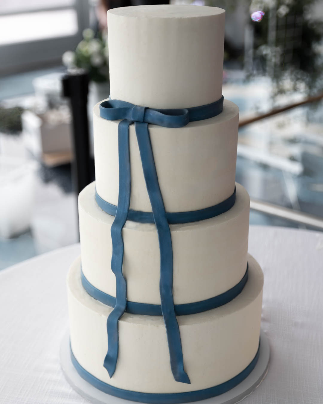Classic buttercream cake with fondant ribbon that can be custom colored