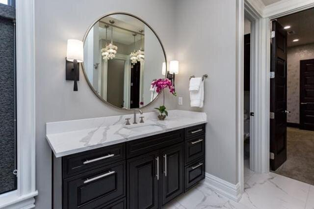 - I love using wall sconces and pendants in bath spaces. Sconces flanking a mirror not only offer a classic look, but they are lighting the sides of your face without casting dark shadows.Amber Pirillo, Interior Designer@AePirilloTrenton Collection