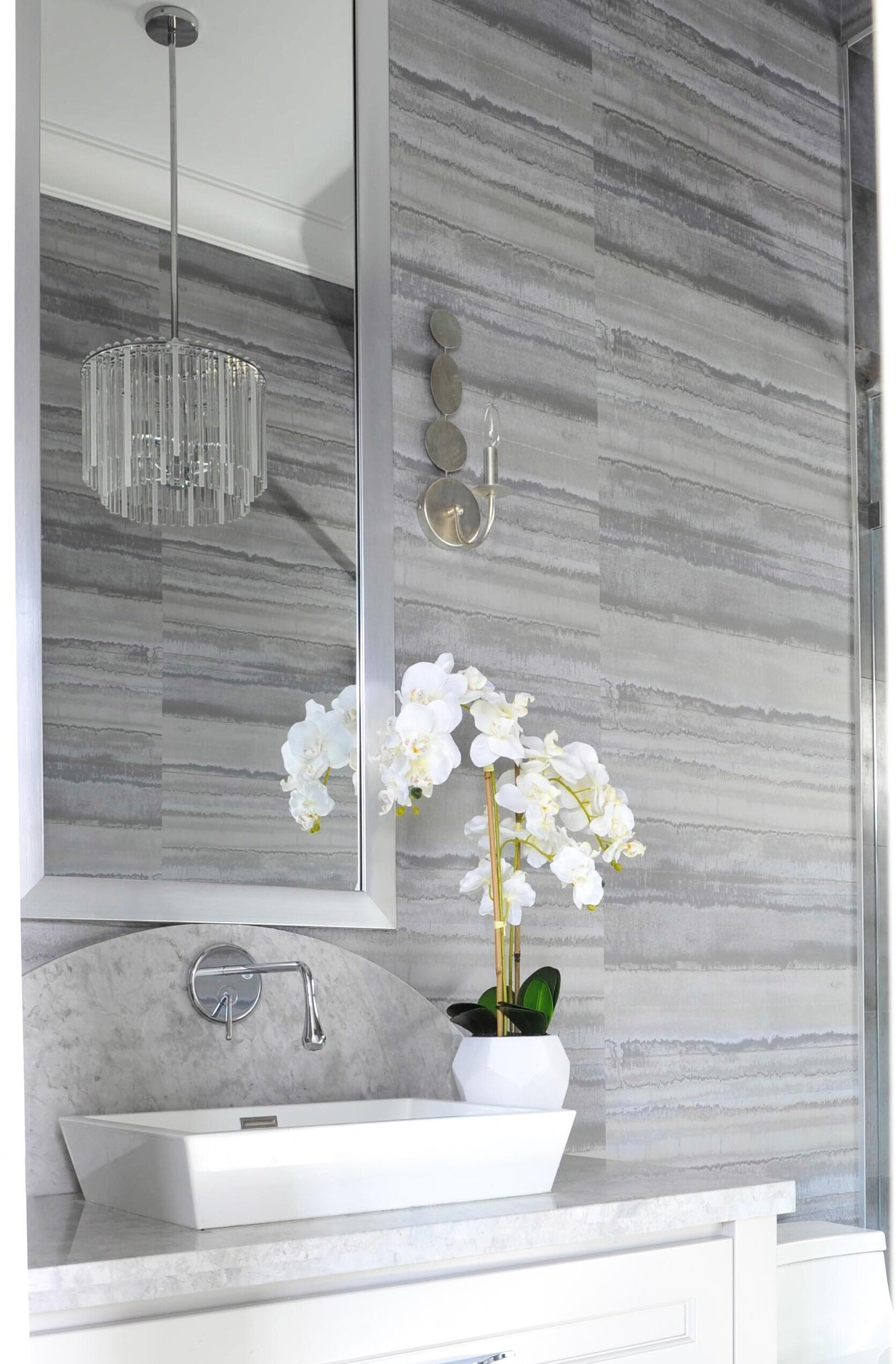- Incorporating a variety of light sources is a very important functional consideration in bathroom design. The wall sconces on either side of the mirror provide an even, flattering light for guests to look their best. The ceiling chandelier, that operates on a separate switch, provides the perfect amount of ambient light as needed and looks stunning whether turned on or off.Paulie DhillonPrincipal/Lead Designer, Design Therapy Interior DesignPhotographer: Tracey Aytonwww.idtherapy.caLayla CollectionBleecker Collection