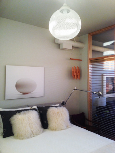 Bedroom with wall mounted light fixtures.