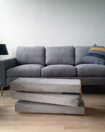 Den : stacked coffee table sculpture.
