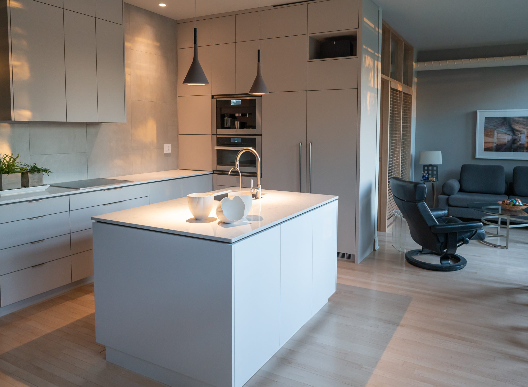 Open Concept Kitchen : bedroom behind wall cabinets..