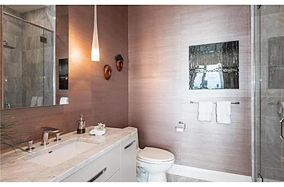 Bathroom : custom vanity + grass wallpaper.
