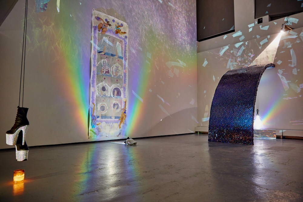 double time (what big homie said to little homie) - 2019, light installation, two video, four flames, flashlights, mirror, boxing gloves, gouache painting on paper, sequins, crystal encrusted pleaser boots, holographics, crushed foam.