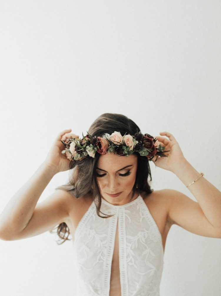 mallory-jacks-of-wildly-yours-weddings-and-elopements-missouri-wedding-planner-designer-in-boho-wedding-dress-wearing-floral-crown.jpg