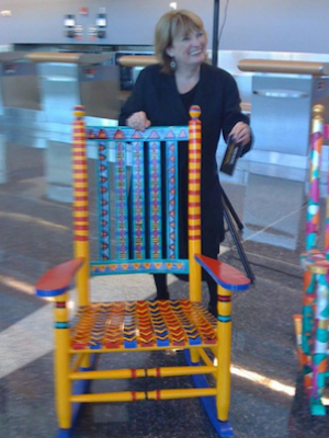 Evelyn with Native Rocker at Logan Airport