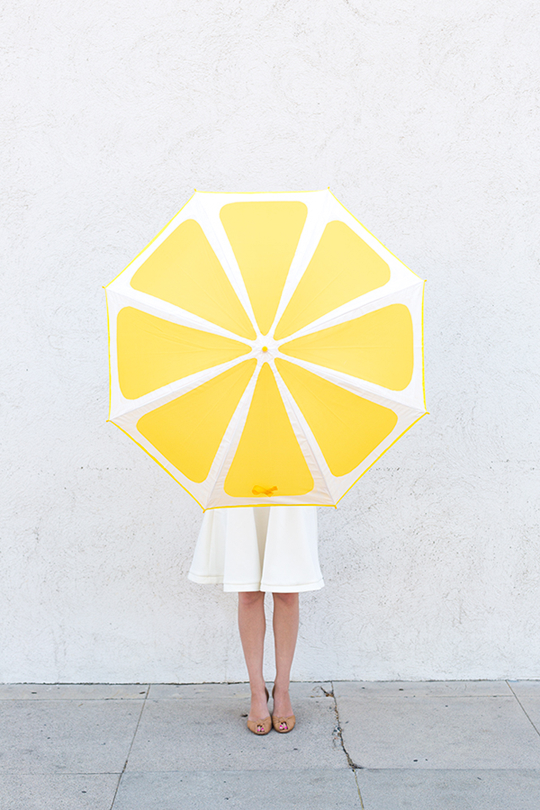 Alternatively make your own fun umbrella and follow this tutorial from  Studio DIY .