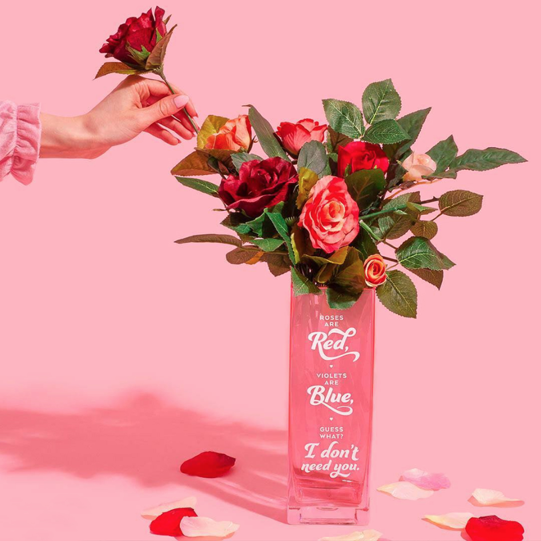 Masters of Instagram Content Creation: Amy Shamblen | Red roses in a vase on a pink background