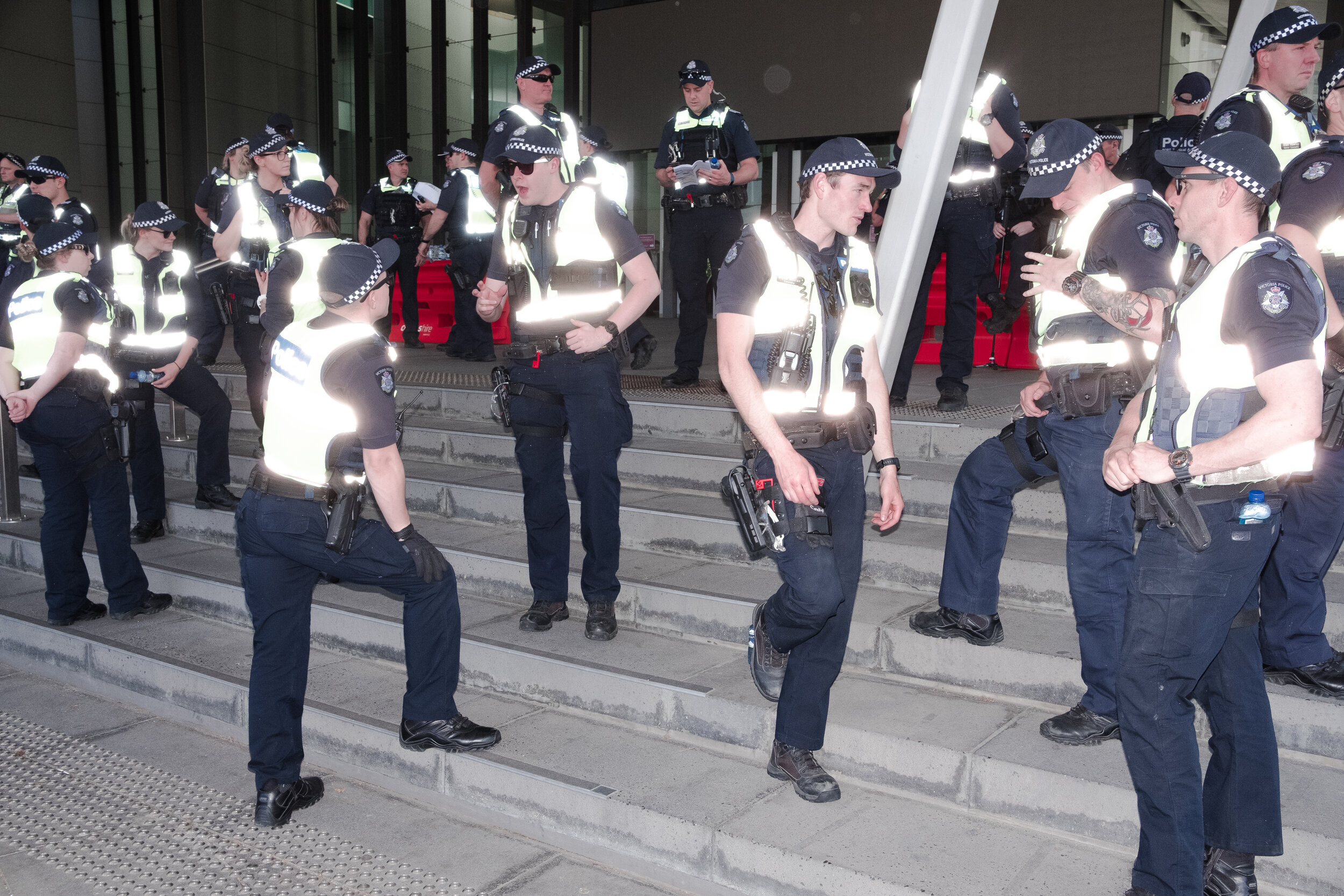 Victorian Police in front of the convention centre preventing activists from entering the conference. (Photo: Jeremy Gan)