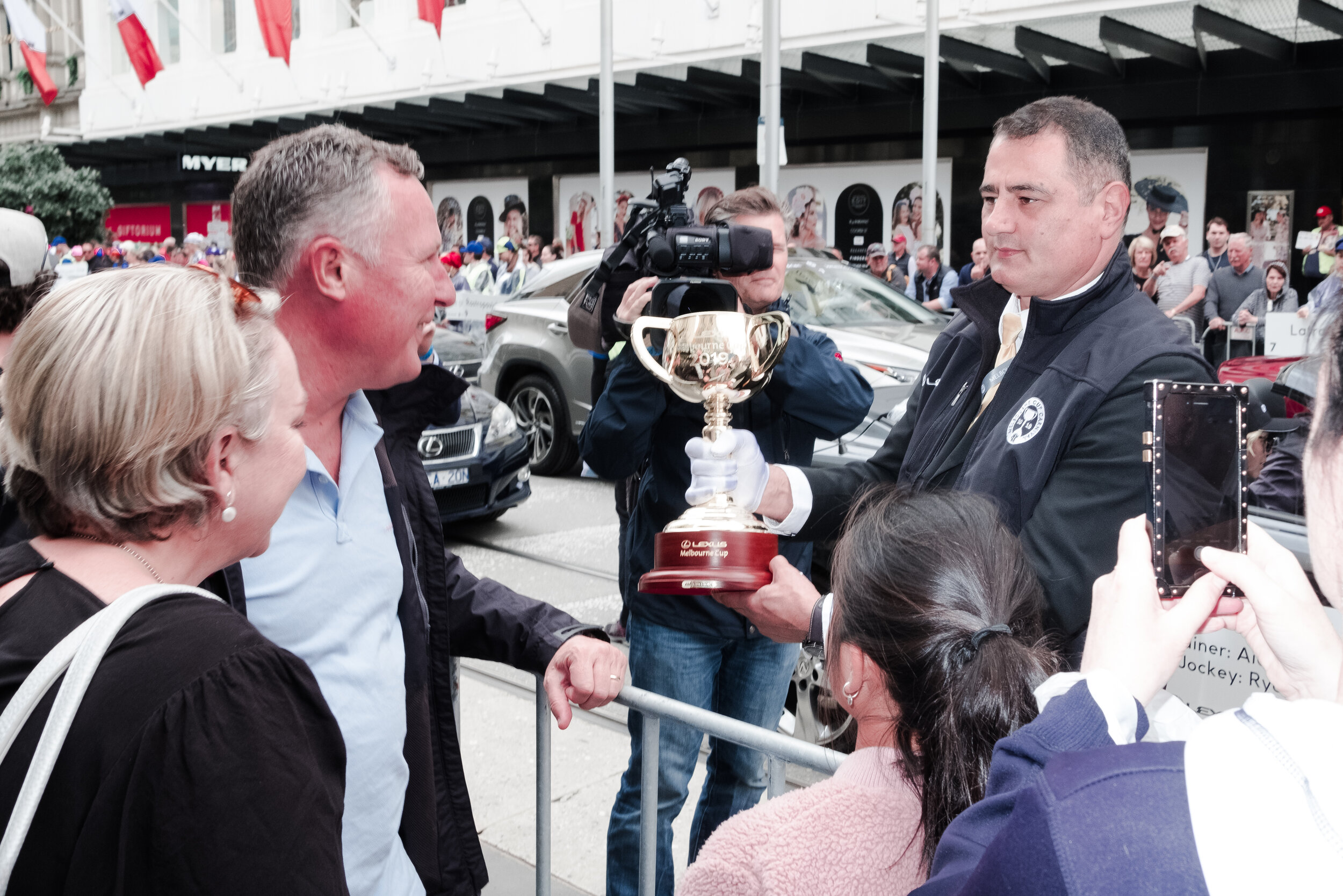 The Melbourne Cup is shown to the crowd. (Photo: Jeremy Gan)