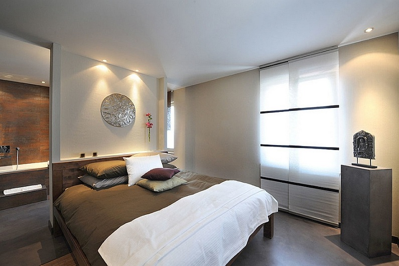 Loft-bedroom-has-an-art-gallery-ambiance.jpg