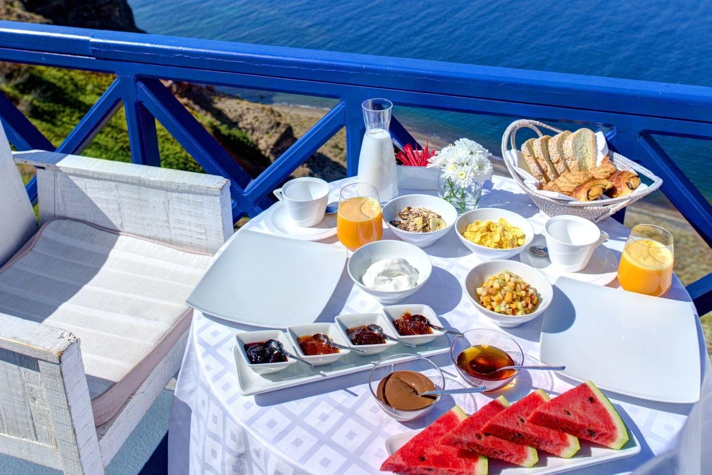 3_Junior_suite_private_couples_Jacuzzi_sea_volcano_caldera_views_Astarte_Suites_Hotel_Santorini_island.jpg