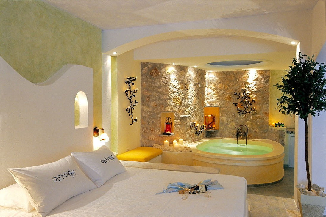 1_Honeymoon_suite_private_couples_Jacuzzi_sea_volcano_caldera_views_Astarte_Suites_Santorini_island.jpg