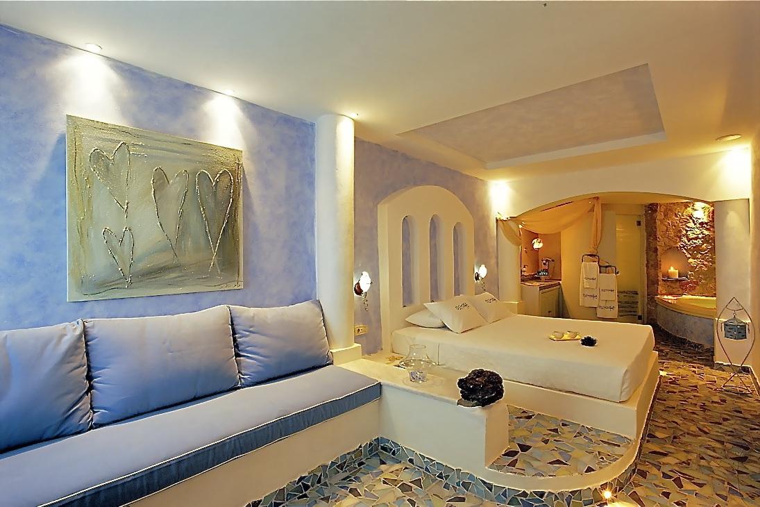1_Senior_suite_private_couples_Jacuzzi_sea_volcano_caldera_views_Astarte_Suites_Hotel_Santorini_island.jpg