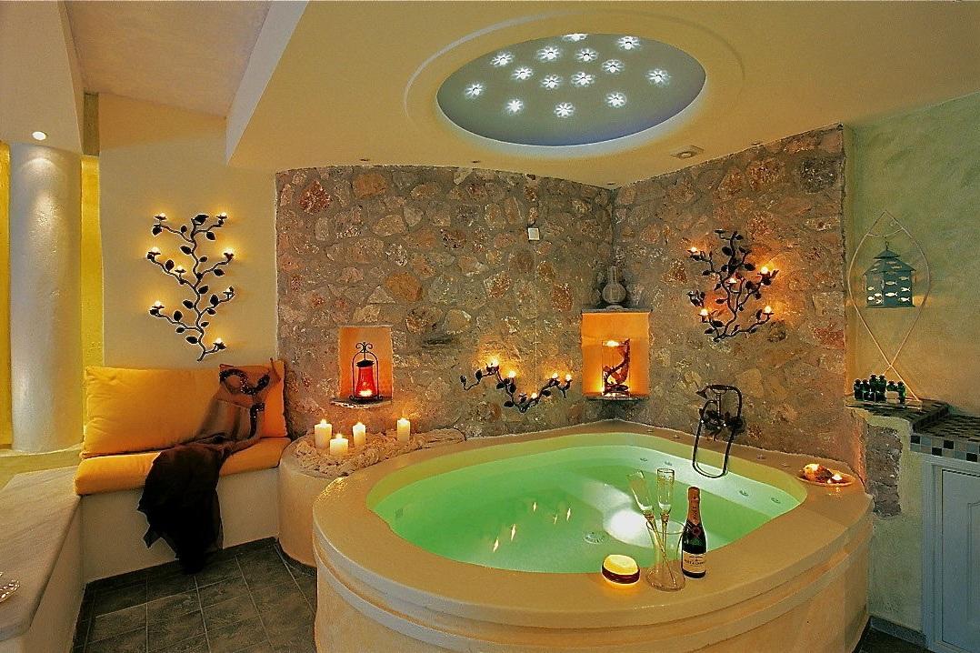 2_Honeymoon_suite_private_couples_Jacuzzi_sea_volcano_caldera_views_Astarte_Suites_Santorini_island.jpg