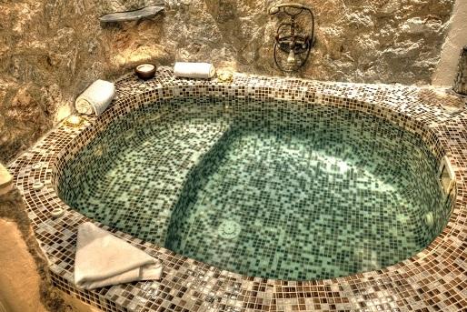 2_Junior_suite_private_couples_Jacuzzi_sea_volcano_caldera_views_Astarte_Suites_Hotel_Santorini_island.jpeg