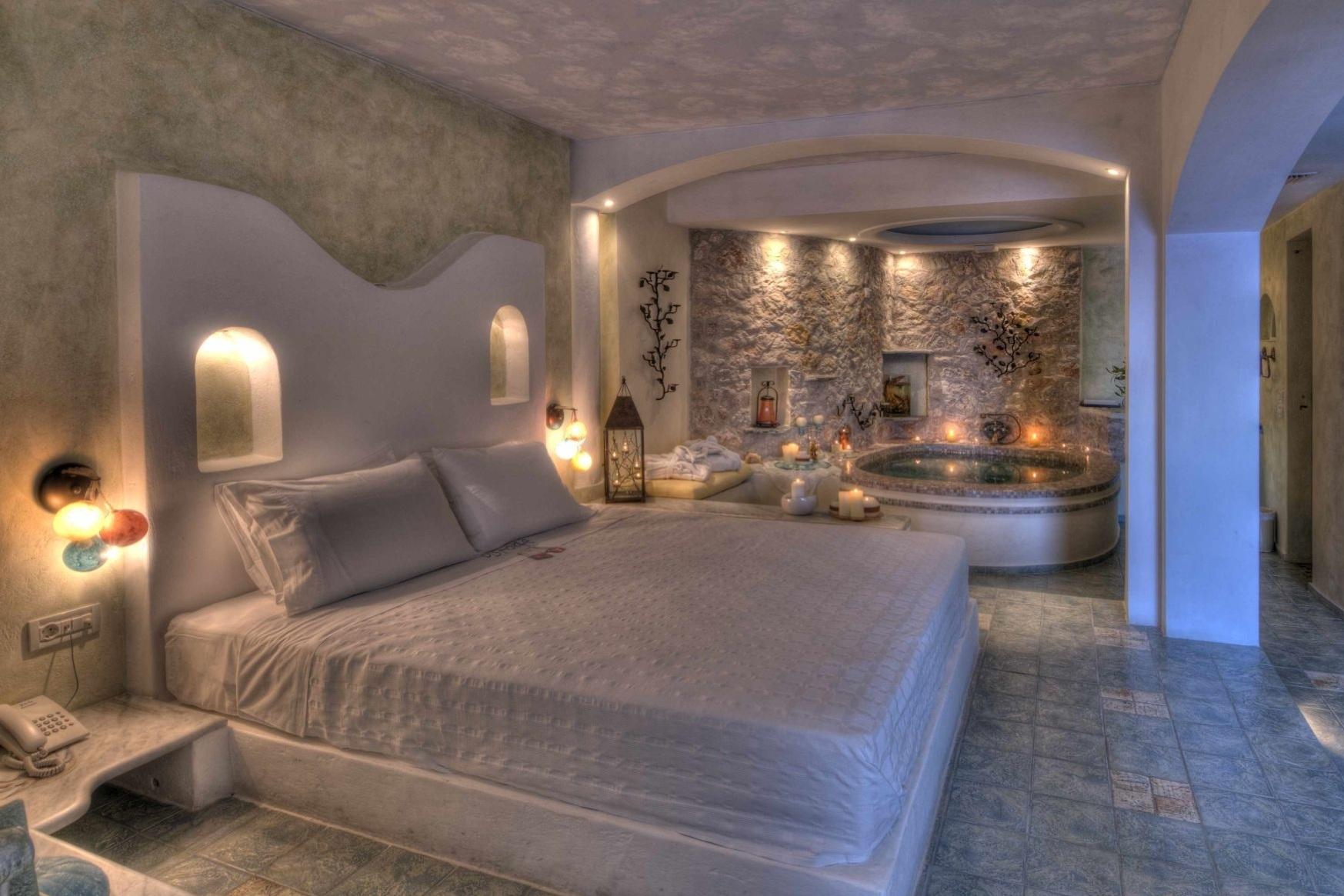 4_Honeymoon_suite_private_couples_Jacuzzi_sea_volcano_caldera_views_Astarte_Suites_Santorini_island.jpg