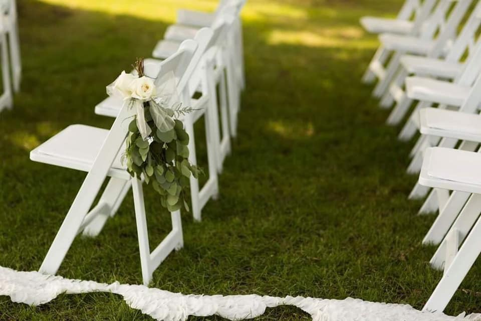 wedding chairs on grass.jpg